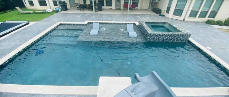 Pool Ideas : Please show me your pools w concrete, stone, travertine or whatever decking used on one side.